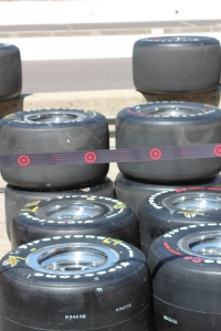 Firestone tires at Indy marked with red and yellow so the tire changers know which side to put them on.