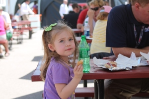 Dave Furst daughter eating chicken nugget at IMS Pagoda Plaza.