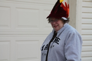 Mom trying on Tanner's turkey hat.