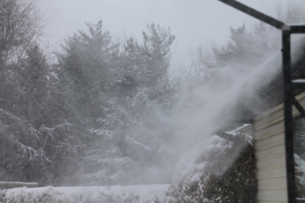 snow blowing off roof