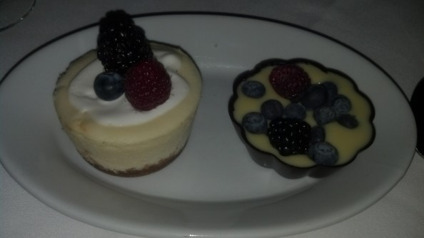 Mini Chocolate chip cheese cake and dark chocolate shell with fresh berries and cream. Aside from my Fuzzy's it was the best part of the meal.