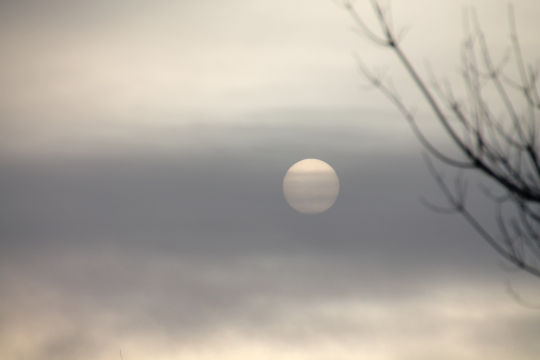 No filter, no photoshop. And no that is not a picture of Jupiter. That is the sun this morning through the icy clouds.